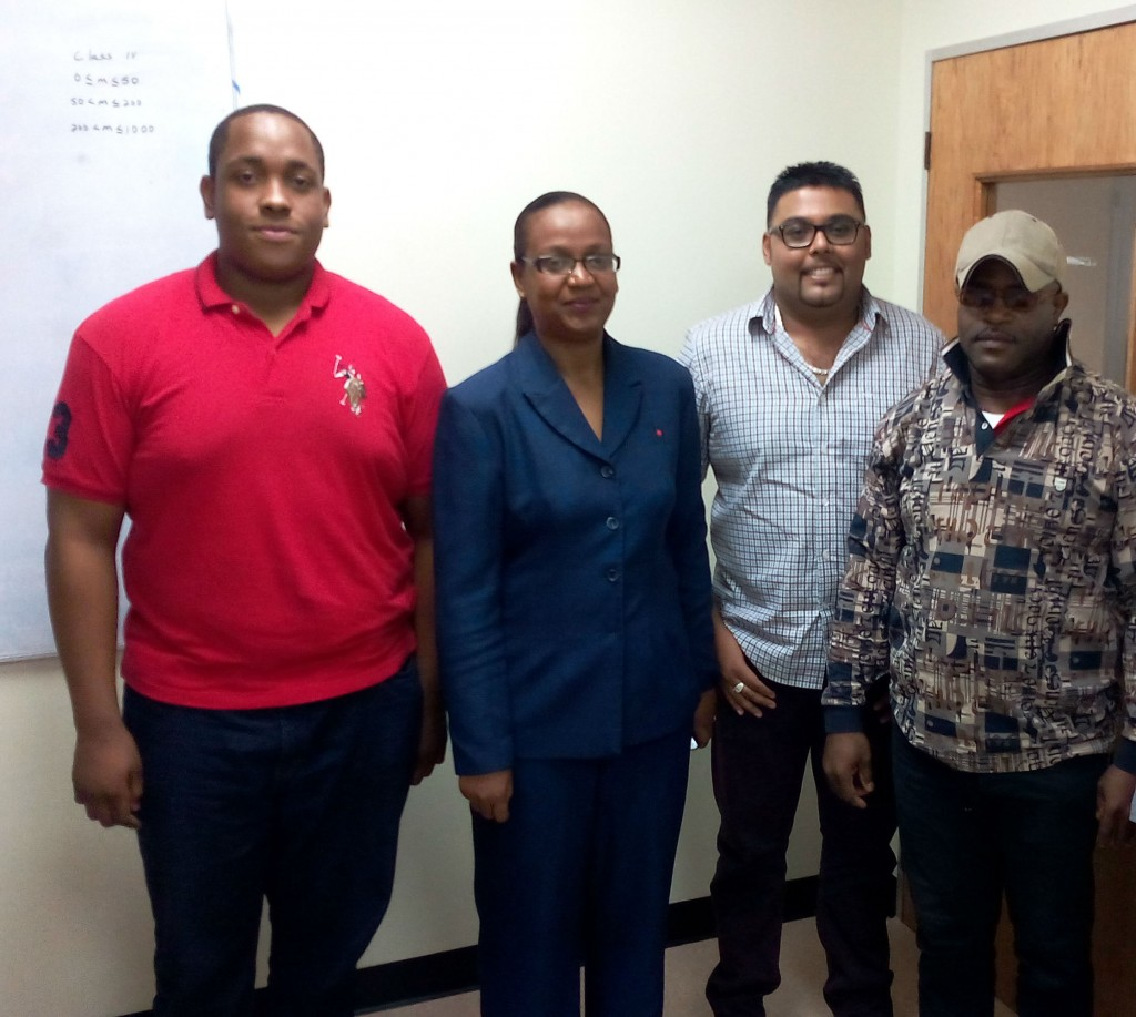 Acting Head of the Metrology Division, Erica Caruth with from left, Jomarie Leblanc, Dhiredj Prahladsingh and Sabin Roosevelt.